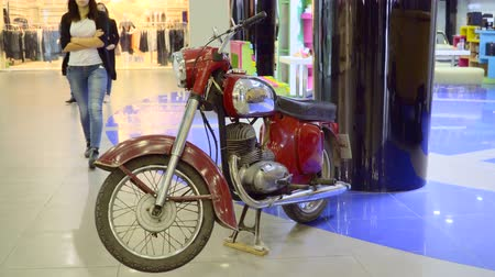 exotikou : Mariupol, Ukraine - October 29, 2016: Exhibition of vintage cars in the mall. Retro motorcycle. Motorcycle Jawa. Dostupné videozáznamy