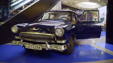 exotikou : Mariupol, Ukraine - October 29, 2016: Exhibition of vintage cars in the mall. Soviet retro cars. GAZ 21 Volga.