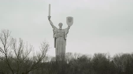 kard : KIEV, UKRAINE - December 14, 2016: The Motherland Monument. Grey clouds Trees without leafs Cloudy day