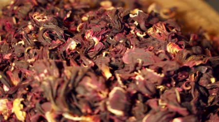 karkade : Hibiscus tea is a herbal tea made as an infusion from crimson or deep magenta-colored calyces (sepals) of the roselle (Hibiscus sabdariffa) flower. It is consumed by both hot and cold.