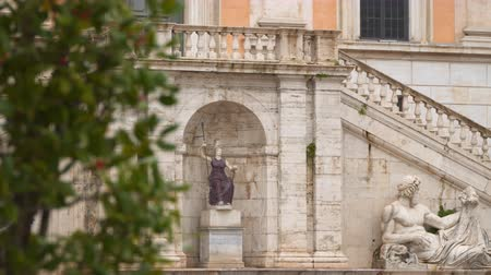 divinity : Rome, Italy - March 19, 2018: Statue of the Tiber and Statue of Minerva - Goddess Roma in the fountain leaning to the Palazzo Senatorio on Capitol in Rome Stock Footage