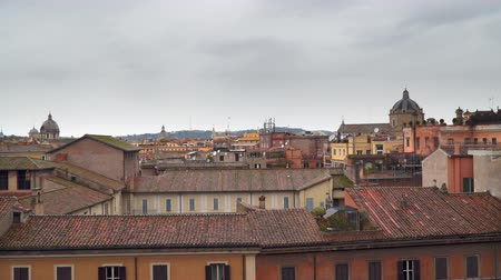 cupola : Cloudy sky over the roofs of houses in Rome Italy