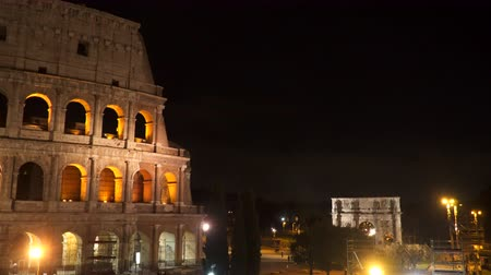 flavian : Rome, Italy. The Coliseum at night. You can also see the Triumphal Arch of Constantine Stock Footage