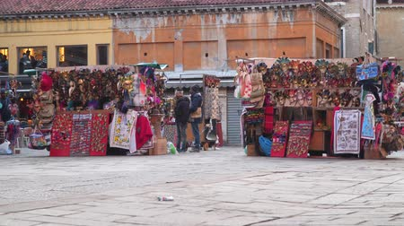 disguise : Venice, Italy - March 23, 2018: Sale of souvenirs and Venetian masks on the market in venice Stock Footage