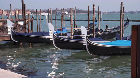 Венеция : Gondolas At The Pier. Venice Italy