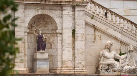 divinity : Rome, Italy - March 19, 2018: Capitol hill in Rome. Statue of the Tiber and Statue of Minerva - Goddess Roma in the fountain leaning to the Palazzo Senatorio Stock Footage