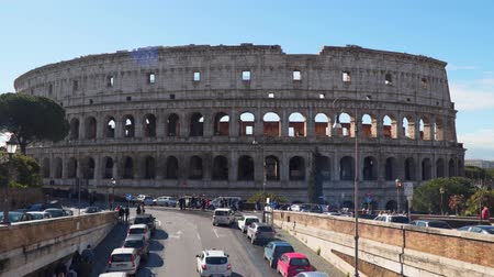 colosseo : Rome, Italy - March 21, 2018: Majestic ancient Colosseum in Rome against blue sky