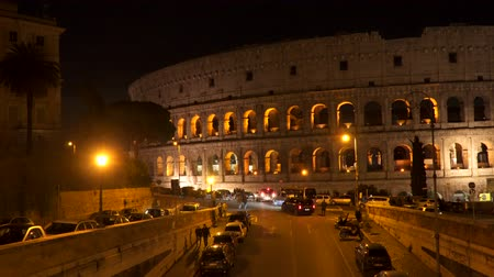 constantine : Rome, Italy - March 21, 2018: Bright illumination of Colliseum at night painting Stock Footage