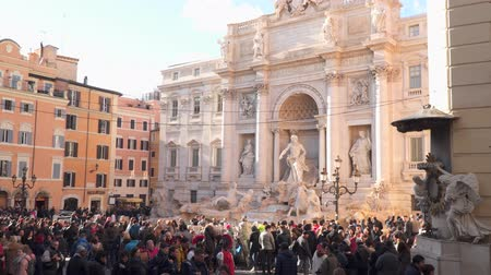 bernini : Rome, Italy - March 19, 2018: Tourists near the Trevi Fountain in Rome Stock Footage