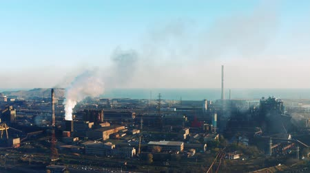 metallurgic : Metallurgical plant with a birds-eye view. Evening time. Environmental pollution. Stock Footage