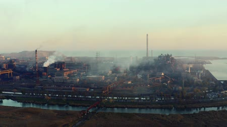metallurgic : Metallurgical plant. Evening time. Environmental pollution aerial video Stock Footage