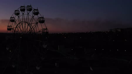 giant wheel : Silhouette of ferris wheel at night. In the background the sky at sunset