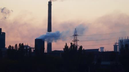carbon dioxide : Environmental pollution. Smoke from a factory pipe. A dawn in city.