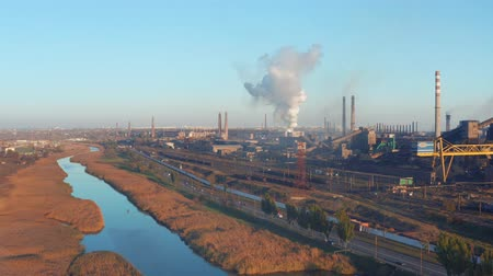 zarostlý : Aerial view. The river is overgrown with reeds near an industrial plant. Evening time Dostupné videozáznamy