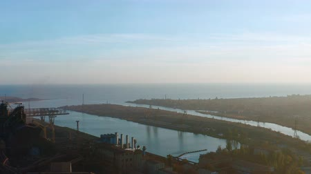 дымоход : Aerial view. Sea bay near industrial enterprise. evening time. Стоковые видеозаписи