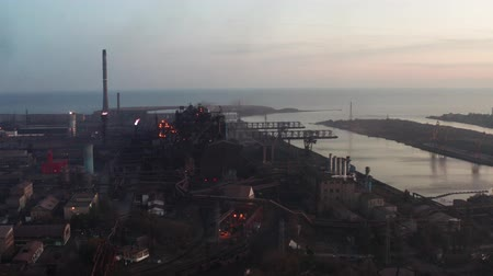 metallurgical plant : Blast furnaces in the evening. Industrial Enterprise is located on the banks of the river. Aerial view