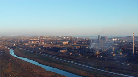 combinado : Environmental pollution. Industrial enterprise on the river bank. Evening time. Aerial view