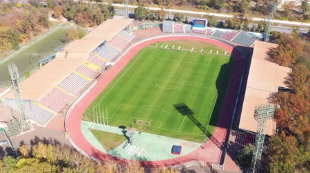 トラック : Mariupol, Ukraine - October 17, 2018: Football stadium From a birds eye view