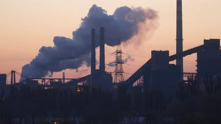 metallurgical plant : Smoke from factory chimneys against predawn sky.