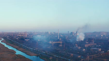emissions : Aerial view of metallurgical plant. Evening time Stock Footage