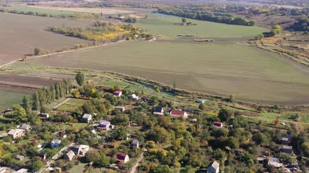 průhled : The village is near arable fields. Aerial view.