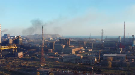 metallurgic : Aerial video. Metallurgical plant on the seashore. Environmental pollution. Evening time Stock Footage