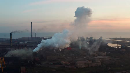 hoogovens : Aerial video. Blast furnaces. Metallurgical plant on the seashore. Environmental pollution. Evening time