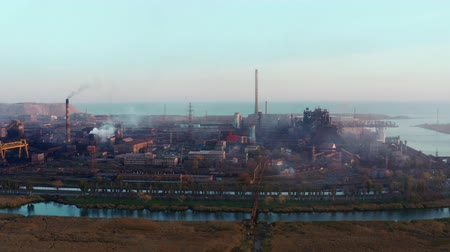 metallurgic : Aerial video. Blast furnaces of a metallurgical plant. Environmental pollution. Evening time