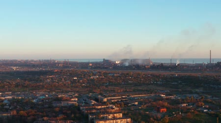 пригородный : Metallurgical plant in the city. Environmental pollution. Evening time is autumn. Aerial view