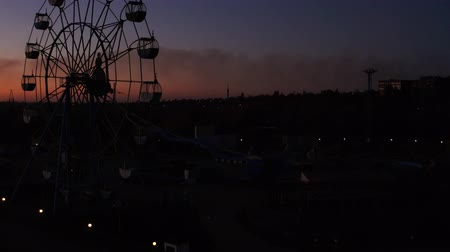 giant wheel : Aerial view. Silhouette of a ferris wheel against the sky at sunset.