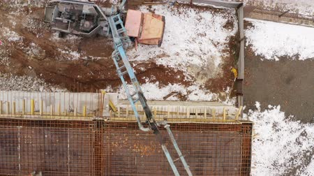 peoples : Construction site. You can see the builders and equipment. Peoples faces are not visible. Aerial view Stock Footage