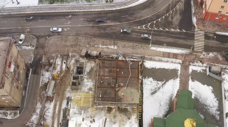 арматура : Construction of the building. Builders poured concrete overlap building. Peoples faces are not visible. Aerial view. Стоковые видеозаписи