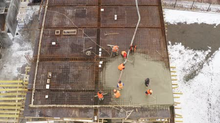 armature : Construction site. Builders poured concrete on the roof of the building. Aerial view