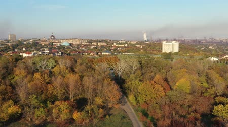 metallurgical plant : Birds eye view. Environmental pollution. Smog over the city from the metallurgical plant. Autumn Evening Time.