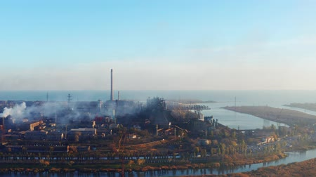 metallurgic : Metallurgical Plant on the seashore. Environmental pollution. Evening time. Aerial view