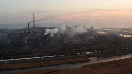 metallurgic : Metallurgical plant on the coast. Environmental pollution. Evening time. Aerial view