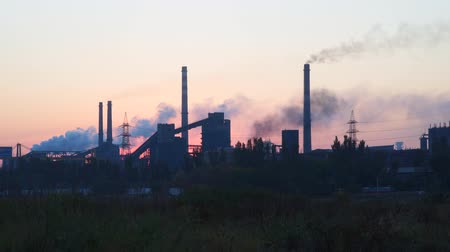 дымоход : Environmental pollution. Smoke from the pipes against the sky at sunrise.