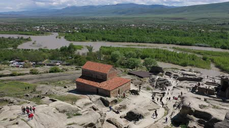 szikla : Aerial view. Uplistsikhe is an ancient cave city, one of the first cities on the territory of Georgia Stock mozgókép