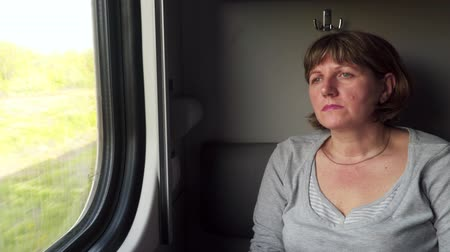 rekesz : Woman on the train looks out the window.