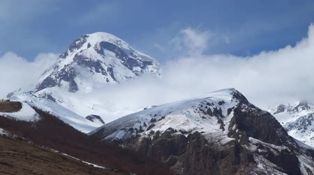 wilderness : Mount Kazbek among the clouds. Stock Footage