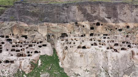 kazılmış : Aerial view of the cave city of Vardzia. Vardzia is a cave monastery site in southern Georgia Stok Video