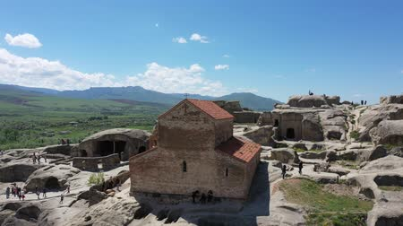 доисторический : Church at Uplistsikhe - the 9th century basilica. Uplistsikhe is an ancient rock-hewn town in eastern Georgia. Aerial view