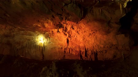 speleology : Underground world. Karst cave. Stalactites and stalagmites. Stock Footage