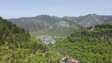plateau : Aerial view of Borjomi city. Borjomi is a resort town in Samtskhe-Javakheti, a region in southwestern Georgia. Stock Footage