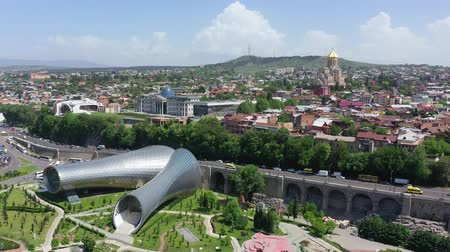 Tbilisi, Georgia - May 8, 2019: A birds eye view of the city of Tbilisi. Bridge of Peace, presidential palace, Sameba - Holy Trinity Cathedral, Rike Park