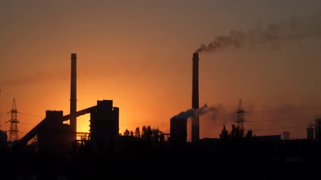 metallurgical : Smoke from pipes of a metallurgical plant at sunrise.