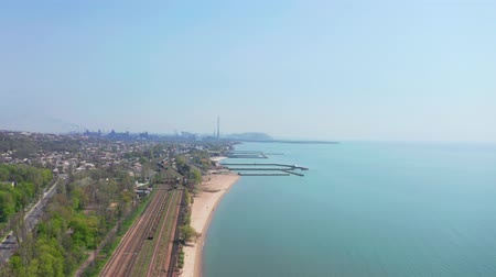 külvárosok : Railway by the sea. Environmental pollution. Aerial view