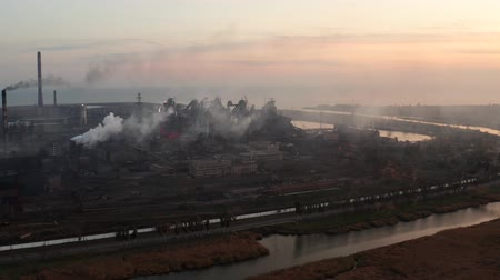 blast furnace : Blast furnaces on the seashore and river. Evening time. Environmental pollution. Aerial view
