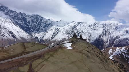 gergeti : The Trinity Church in Gergeti is located at an altitude of 2,170 m at the foot of Kazbek along the Georgian Military Highway in the Georgian village of Gergeti. Aerial view
