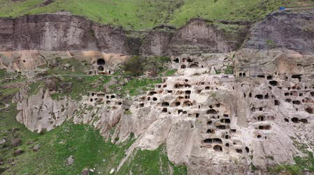 kazılmış : Aerial view. Vardzia is a cave monastery site in southern Georgia Stok Video